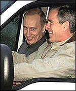 President Bush drives President Putin around his Texas ranch