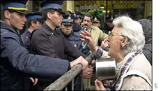 Demonstrators argue with police officers near Buenos Aires Congress on Wednesday