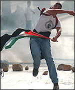 [ image: Back on the West Bank there has been intermittent violence]