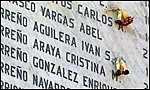 [ image: A memorial naming 2,500 people who died during Pinochet's rule.]