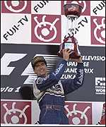 [ image: Hill celebrates winning both the Japanese GP and the 1996 F1 crown]