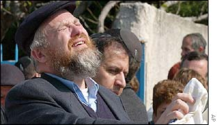 Jewish man on site of a synagogue burnt down in Marseilles
