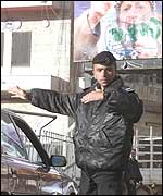 A Palestinian policeman directs traffic in central Ramallah