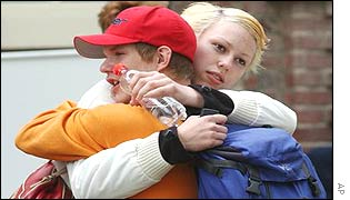 Pupils hug outside the school