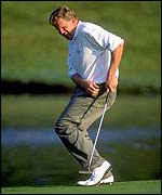 Colin Montgomerie watches a vital putt slide by in 1997
