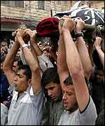 Mourners carry the body if Islamic Jihad leader Sheikh Riad Bider, killed in Jenin