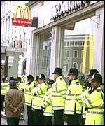 Police officers line up outside a McDonalds restaurant in central London