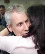 Peter Norris hugs his wife after sentencing