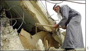 Man works on his house in Jenin