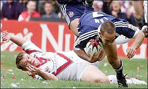 Wigan's Adrian Lam skips past St Helens Keiron Cunningham to score a try