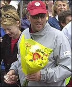 Ian Botham finishes his fundraising walk in Cardiff