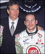 Craig Pollock stands with Jacques Villeneuve at a team launch