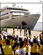 South Korean Red Cross officials wave goodbye to ship