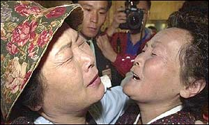 Two Korean women embracing