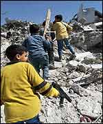 Palestinian children play in the rubble in Jenin