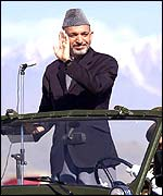 Afghan interim leader Hamid Karzai taking the salute at the parade