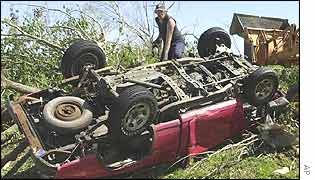 A man prepares to recover a pickup truck in Dongola, Illinois