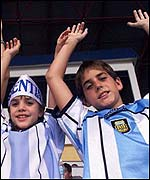 Two young Argentina fans celebrate