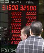 Observers watch exchange rate boards