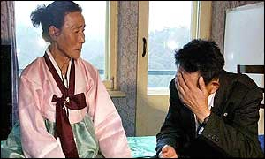 South Korean Chung Gwi-up sits next to her North Korean husband, Lim Han-un
