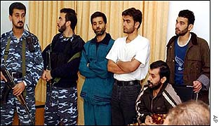 Two Palestinian guards with Hamdi Qoraan, Bassel al-Asmar, Ahed abu Gholma and Mejdi Rehmi