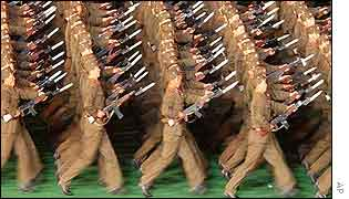 North Korean soldiers holding rifles march during the opening event of Arirang Festival