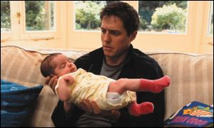 Hugh Grant holds the baby in About a Boy