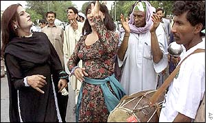 Eunuchs dance, celebrating the referendum outside the polling station where General Musharraf cast his vote