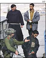 Palestinian officer being escorted to meet Israeli soldiers