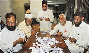 Polling agents in Islamabad count the votes