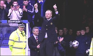 Alex McLeish salutes the Rangers fans at Ibrox in December