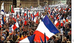 Le Pen supporters march through Paris
