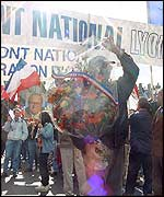 National Front protesters carry bouquets