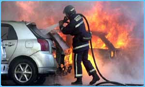 Fireman tackles fire caused by car bomb