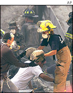 Firefighters and rescue workers help those injured shortly after the attacks