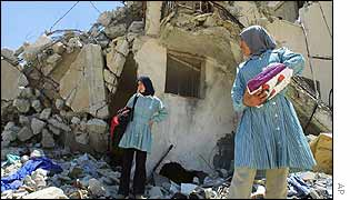 Women outside their damaged house in Jenin