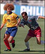 Carlos Valderrama takes on John Harkes of the USA