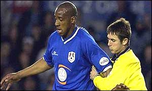 Bryan Hughes of Birmingham and Millwall's Dion Dublin tussle