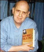 TC Campbell with book
