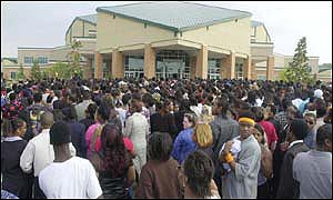 A crush of people try to get inside the New Birth Missionary Baptist Church in Lithonia