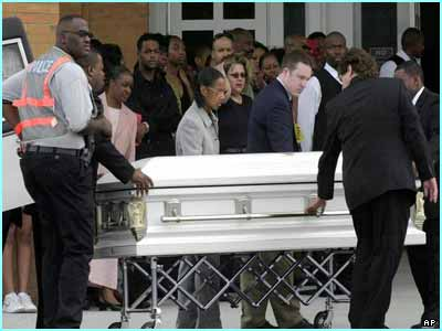 Mourners watched as the casket of Lisa Left Eye Lopes was brought into
