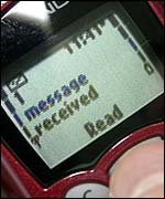 Text message arriving on mobile phone, BBC