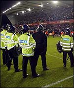 Police attempt to control the crowd at Millwall