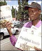 A paper vendor in Harare