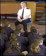 Inspector Dave Hollingsworth talks to pupils