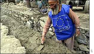 Afghan man works on a new waterway in Kabul funded by European Union money