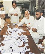 Polling station officials count votes