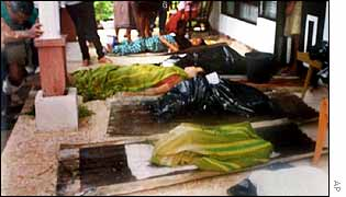 Mourners lay out the bodies of Christians killed near Ambon
