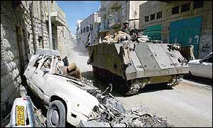 Israeli army vehicle patrols Bethlehem streets