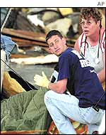 Rescue workers treat a young boy injured in the tornado